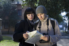 Couple Reading Map Outdoors Stock Photo