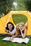 Couple Reading Map in Tent Royalty Free Stock Image