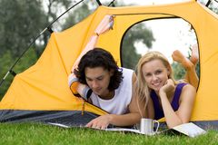 Couple Reading Map in Tent Royalty Free Stock Photography
