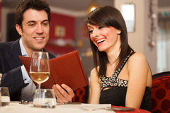 Couple reading the menu. In a restaurant Stock Images