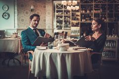 Couple reading menu in a restaurant stock photo