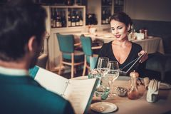 Couple reading menu in a restaurant stock images