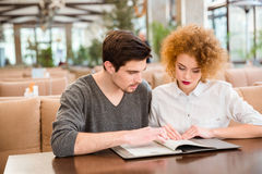 Couple reading menu in restaurant Stock Images