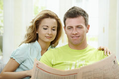 Couple reading newspaper Stock Photos