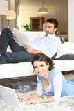 Couple reading newspaper Stock Photography
