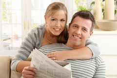 Couple reading newspaper Stock Images