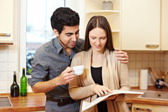 Couple Reading Newspaper Together Stock Photos