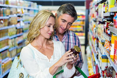 Couple reading nutritional values of food Stock Photo