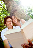 Couple reading outdoors Royalty Free Stock Images