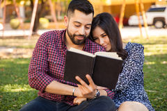 Couple Reading Outdoors Stock Photo