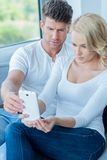Couple reading a text message with consternation Royalty Free Stock Images