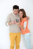 Couple reading text messages being surprised Stock Image