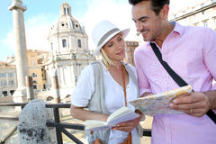 Couple reading  tourist book in Rome Royalty Free Stock Photo