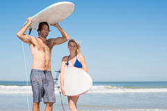 Couple ready for surfing Stock Image