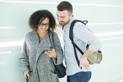 Couple ready to go on vacation using travel app Royalty Free Stock Image