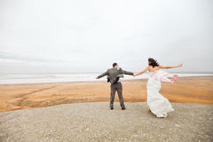Couple ready to jump on the mountain. Bride and groom on the mountain ready to jump Royalty Free Stock Photos