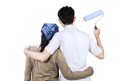 Couple ready to painting wall. isolated Stock Photos
