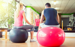 Couple ready for workout with fitball Stock Images