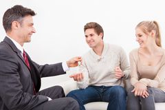 Couple with real estate agent Stock Images