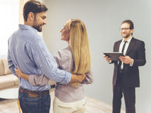 Couple and a realtor stock image
