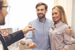Couple and a realtor stock photography