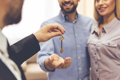 Couple and a realtor Royalty Free Stock Images