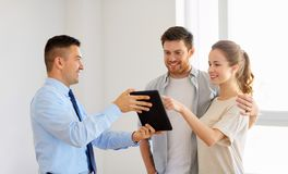 Couple and realtor with tablet pc at new home Stock Photography