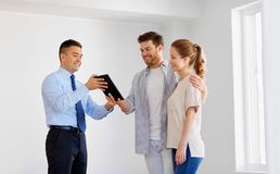 Couple and realtor with tablet pc at new home Stock Images