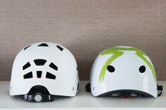Couple rear helmet for bicycle. On the table Royalty Free Stock Photo