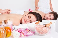 Couple receiving an acupuncture treatment Stock Image