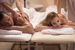Couple receiving a back massage Stock Images