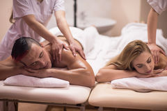 Couple receiving a back massage Royalty Free Stock Photo