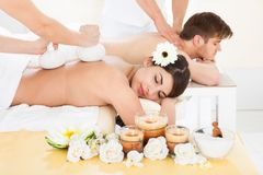 Couple Receiving Back Massage In Spa Stock Photos
