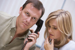 Couple Receiving Bad News Over Phone Stock Photo