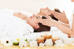 Couple receiving head massage Royalty Free Stock Photography
