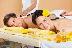Couple Receiving hot stone Therapy At Spa Royalty Free Stock Photo