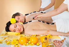 Couple Receiving hot stone Therapy At Spa Royalty Free Stock Photos
