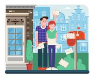 Couple Receiving Mail from Letterbox. Young couple getting mail from mailbox full of envelopes. Man and woman receiving letters near opened postbox. City postal Royalty Free Stock Photo