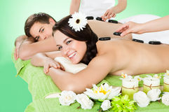 Couple Receiving Massage With Herbal Compress Stamps At Spa Royalty Free Stock Photography