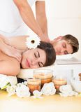 Couple receiving massage at spa Stock Images