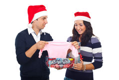 Couple receiving surprising news at Christmas Royalty Free Stock Image