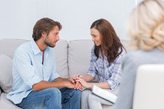 Couple reconciling on the couch royalty free stock photos