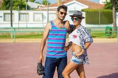 Couple recording with movie camera Royalty Free Stock Photos