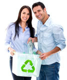 Couple recycling bottles Stock Image