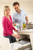 Couple Recyling Waste At Home stock photo