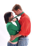 Couple in Red and Green Stock Image
