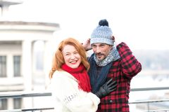 Couple in red. Guy in hat and red hair girl. Happy woman hugs man. Guy dressed hat and smiling woman with scarf. stock photos