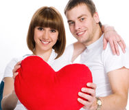 Couple with a red hear Royalty Free Stock Photo