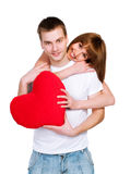 Couple with a red hear Stock Images