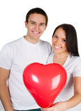 Couple with a red heart Stock Photography